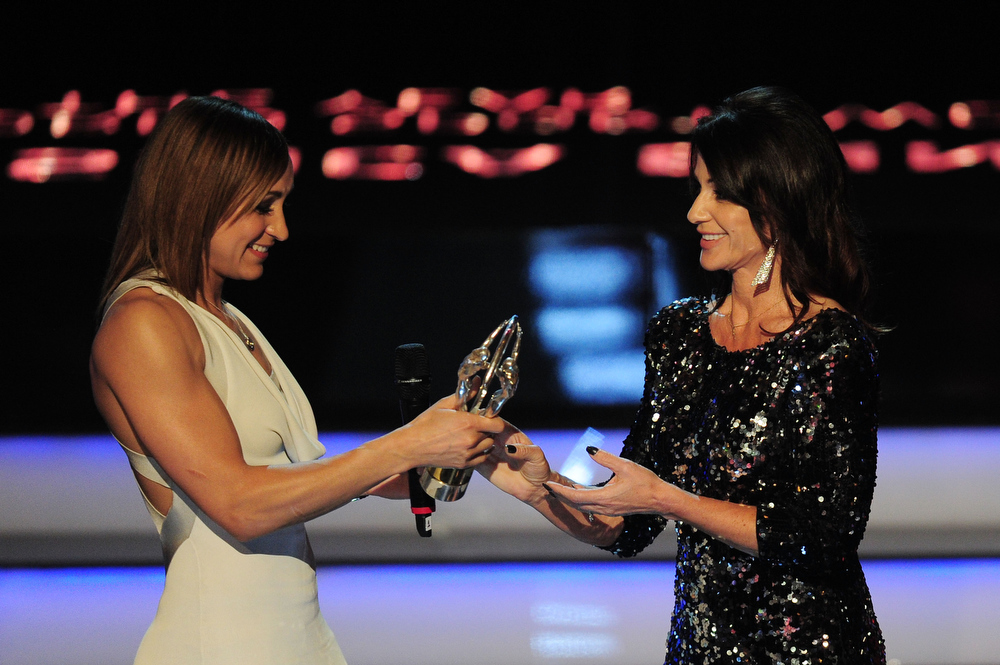 """. Track and field athlete Jessica Ennis receives her award for \""""Laureus Sportswomen of the Year\"""" from Laureus Academy Member Nadia Comaneci on stage during the awards show for the 2013 Laureus World Sports Awards at the Theatro Municipal Do Rio de Janeiro on March 11, 2013 in Rio de Janeiro, Brazil.  (Photo by Jamie McDonald/Getty Images For Laureus)"""