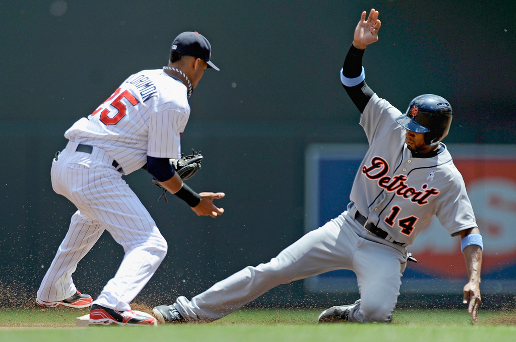 . Detroit\'s Austin Jackson steals second base as Twins shortstop Pedro Florimon fields the ball during the first inning. (Photo by Hannah Foslien/Getty Images)