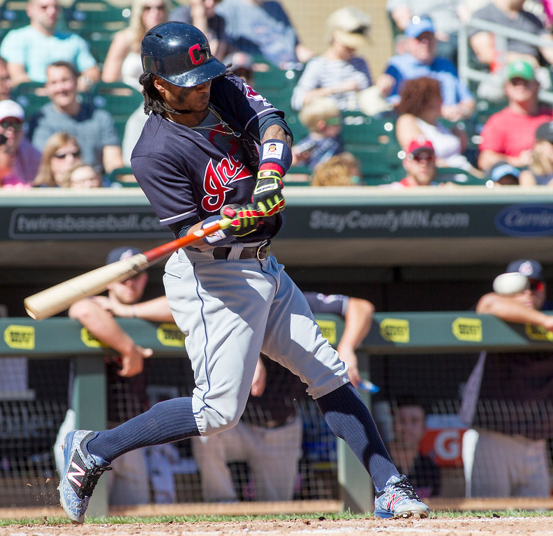 . Cleveland Indians\' Michael Martinez (1) connects for a single against the Minnesota Twins during the fourth inning of a baseball game, Sunday, Sept. 11, 2016, in Minneapolis. (AP Photo/Paul Battaglia)