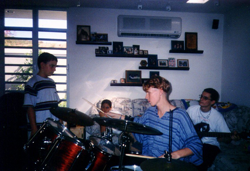 Bryan Drumming With Bad Hair