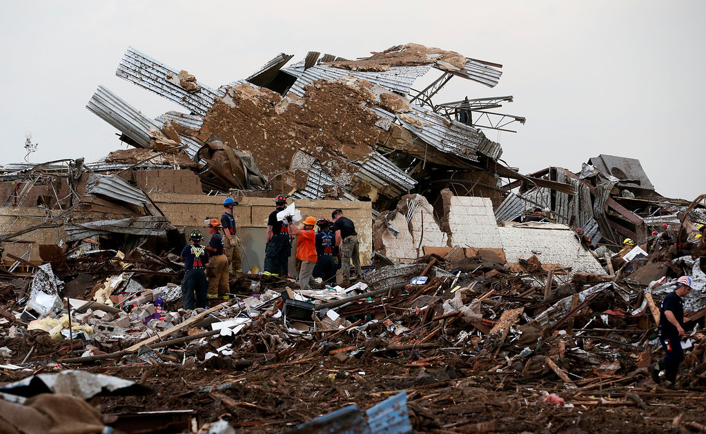 . Workers continue to dig through the rubble of Plaza Towers Elementary School after a tornado moved through Moore, Okla., Monday, May 20, 2013. (AP Photo Sue Ogrocki)