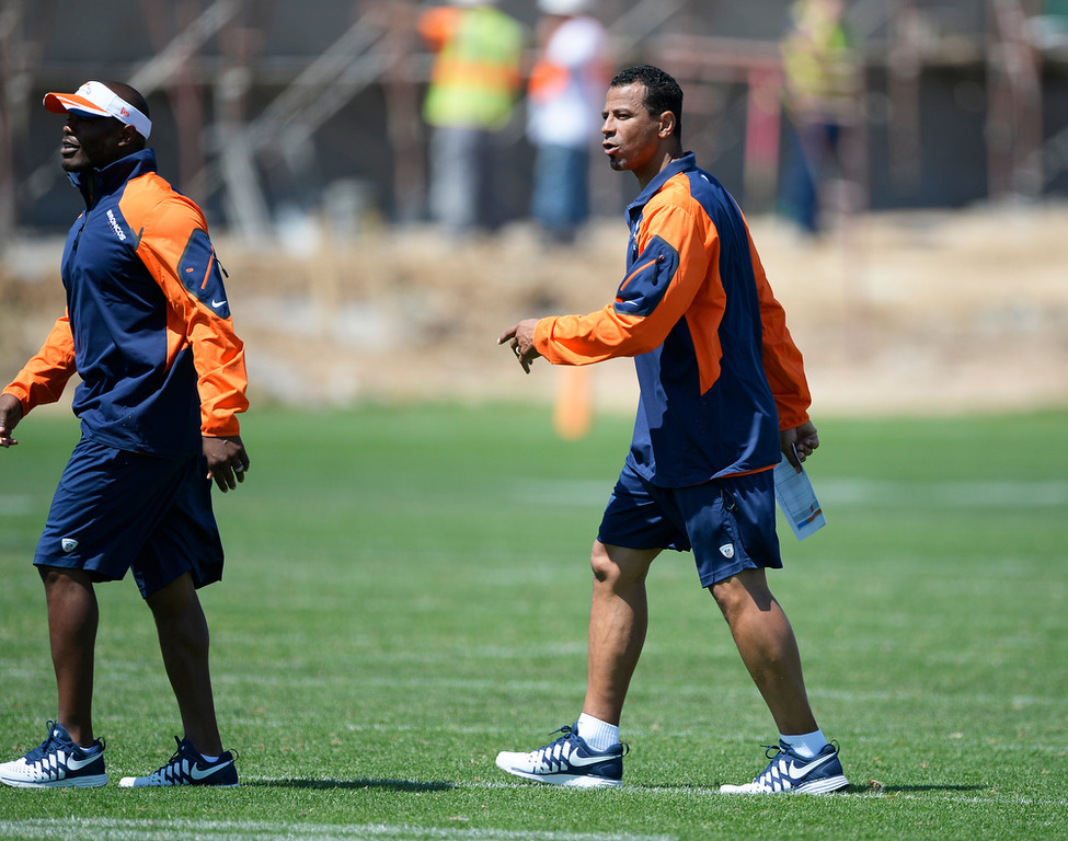 . Denver Broncos Minority Coaching Intern Rod Woodson heads to drills during OTAs June 12, 2014 at Dove Valley. (Photo by John Leyba/The Denver Post)