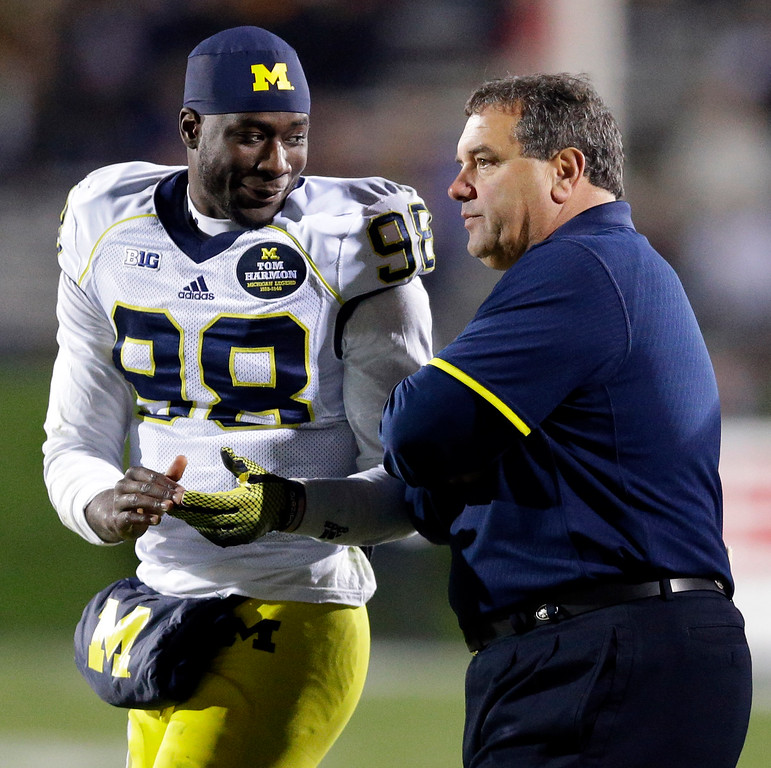 . Michigan quarterback Devin Gardner (98) smiles as he talks with head coach Brady Hoke during the second half of an NCAA college football game against Northwestern in Evanston, Ill., Saturday, Nov. 8, 2014. Michigan won 10-9. (AP Photo/Nam Y. Huh)