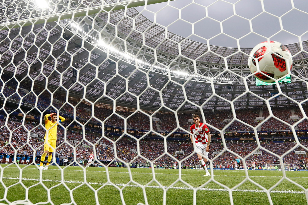 . France goalkeeper Hugo Lloris holds his head as Croatia\'s Mario Mandzukic scores his side\'s second goal during the final match between France and Croatia at the 2018 soccer World Cup in the Luzhniki Stadium in Moscow, Russia, Sunday, July 15, 2018. (AP Photo/Natacha Pisarenko)