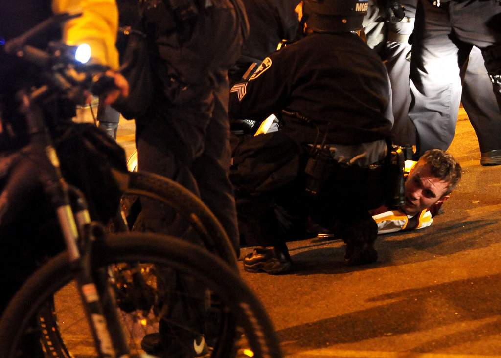 . A U of M hockey fan gets arrested in Dinkytown by Minneapolis Police on Saturday night after the fans went into the street after the loss to Union in the Frozen Four Championship game. (Pioneer Press: Sherri LaRose-Chiglo)