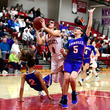 2/26/2019 Mike Orazzi   Staff Berlins Lyzi Litwinko (4) and Plainville's Samantha Lozefski (2) and Jaida Vasquez (5) during the CIAC 2019 State Girls Basketball Tournament with Plainville at Berlin High School Tuesday night.