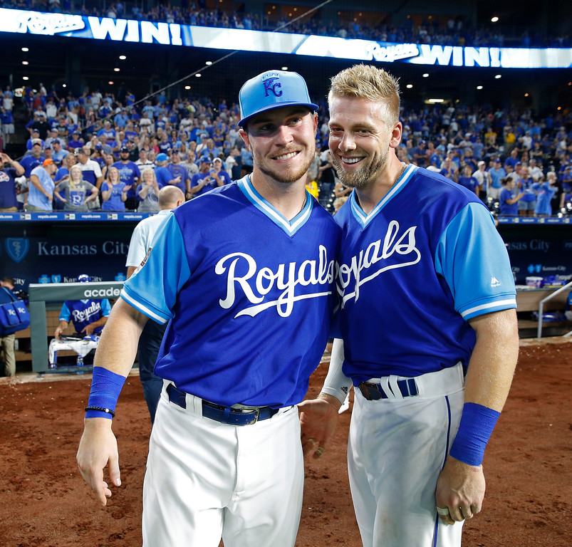 . Kansas City Royals\' Ryan O\'Hearn, left, and Hunter Dozier congratulate each other after the Royals\' 5-4 win in a baseball game against the Cleveland Indians on Friday, Aug. 24, 2018, in Kansas City, Mo. Each of the two hit a solo home run in the ninth inning. (AP Photo/Charlie Riedel)