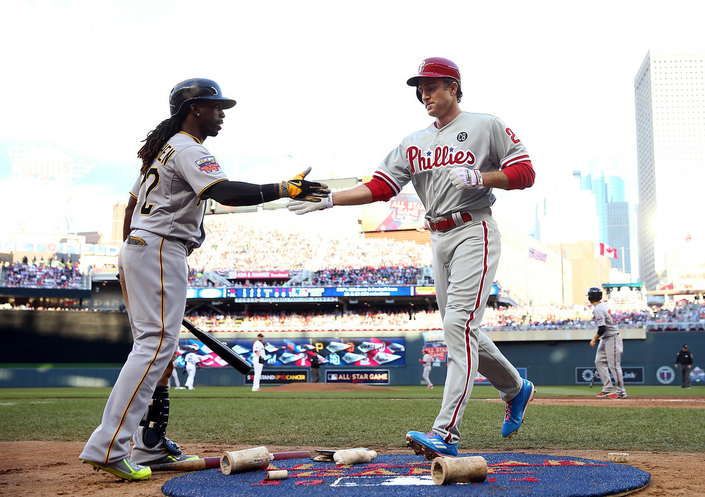 . National League All-Star Chase Utley #26 of the Philadelphia Phillies celebrates with Andrew McCutchen #22 of the Pittsburgh Pirates against the American League All-Stars during the 85th MLB All-Star Game at Target Field on July 15, 2014 in Minneapolis, Minnesota.  (Photo by Elsa/Getty Images)