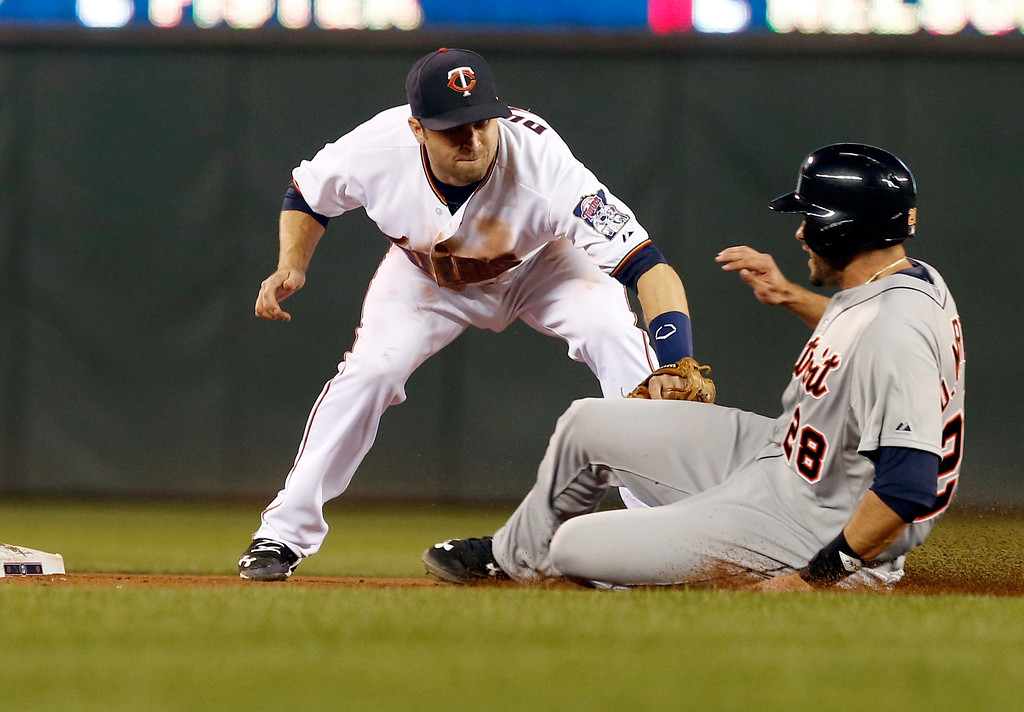 . Detroit Tigers� J.D. Martinez, right, is tagged out trying to steal second by Minnesota Twins second baseman Brian Dozier in the eighth inning of a baseball game, Monday, April 27, 2015, in Minneapolis. The Tigers won 5-4. (AP Photo/Jim Mone)