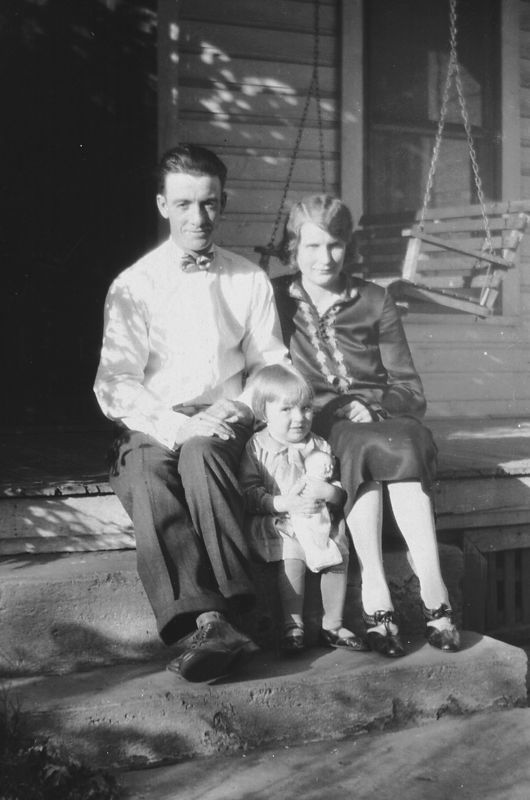 George and Ada Glines with baby Helen.  I'm guessing this picture is taken ca. 1927 because Helen looks like she's almost 2.  This picture may have been taken in front of Telitha Glines' home.