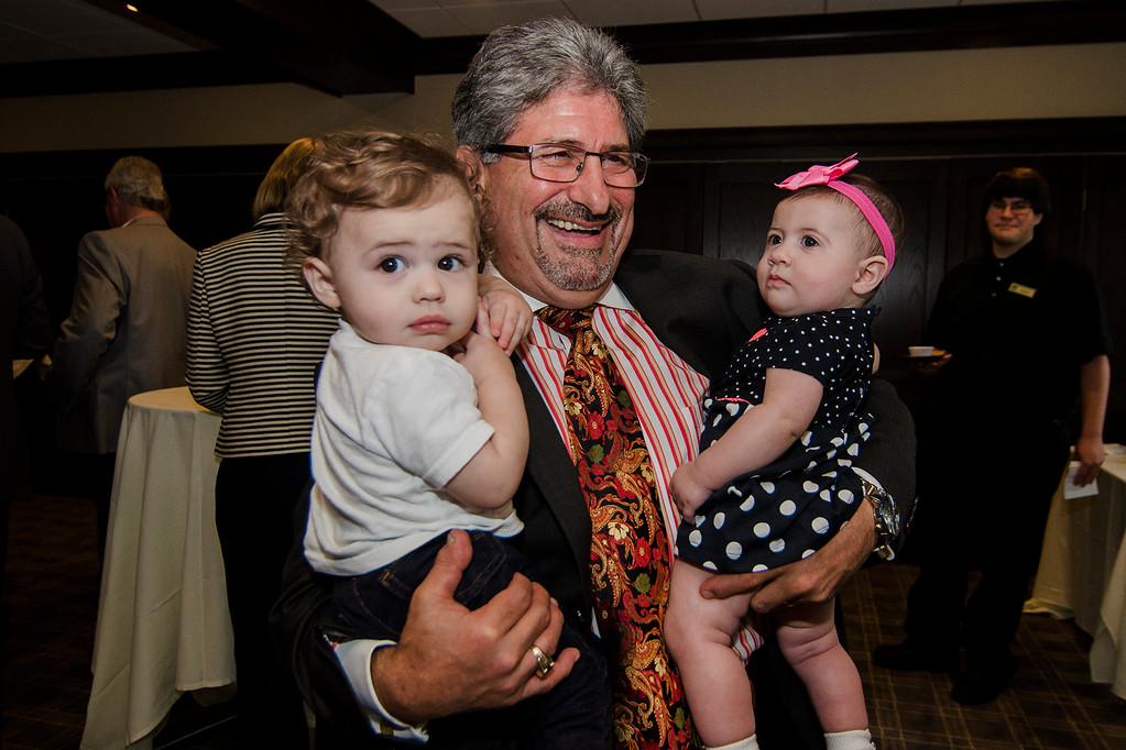 . Mayor Stephen DiNatale holds his grandchildren, John DiNatale and Rena Cardinale during the fundraising event for DiNatale\'s campaign held at Oak Hill Country Club and sponsored by Ken Ansin and Jeff Crowley on Wednesday, September 20, 2017. SENTINEL & ENTERPRISE / Ashley Green