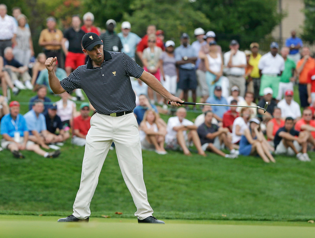 . International team player Charl Schwartzel, of South Africa, reacts to making a birdie putt on the fourth hole during a foursome match at the Presidents Cup golf tournament at Muirfield Village Golf Club, Friday, Oct. 4, 2013, in Dublin, Ohio. (AP Photo/Darron Cummings)