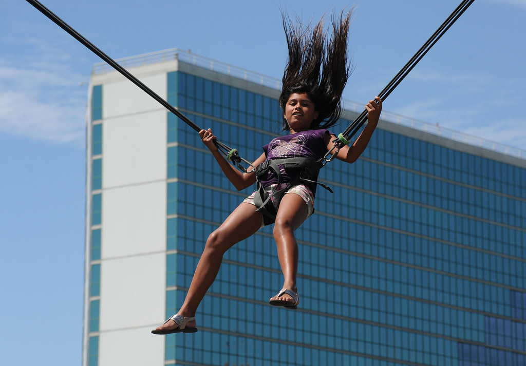 . The 17th Annual Original Lobster Festival at Rainbow Lagoon Sunday, September 08, 2013, in Long Beach.  A girl takes a ride on a giant bungee and trampoline ride at the festival. Photo by Steve McCrank / Daily Breeze