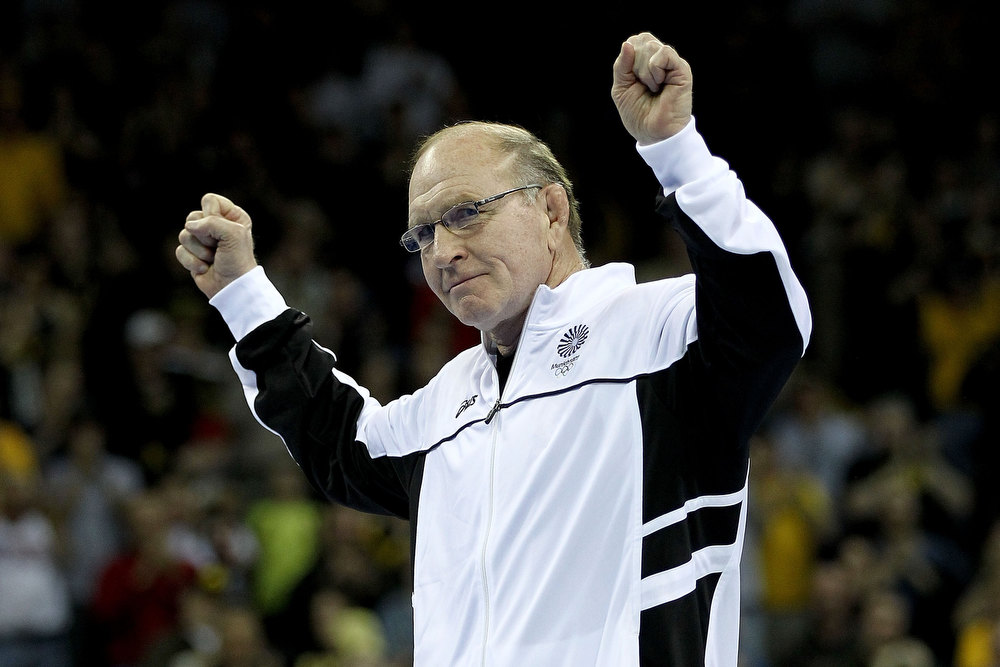 Description of . Dan Gable acknowledges the crowd after being introduced as part of the 1972 Olympic team during the finals of the US Wrestling Olympic Trials at Carver Hawkeye Arena on April 21, 2012 in Iowa City, Iowa.  (Photo by Matthew Stockman/Getty Images)