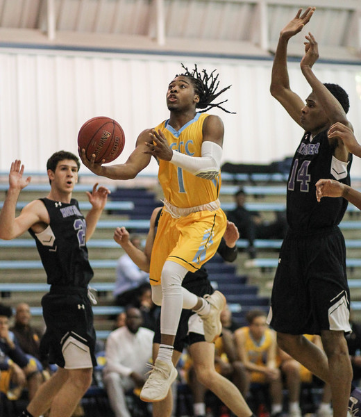 January 23, 2019: PGCC guard Tunde Scrivner (1) drives to the basket past Montgomery defenders during JUCO mens basketball action between Montgomery Community College and Prince George's Community College in Largo. Photo by: Chris Thompkins/Prince Georges Sentinel