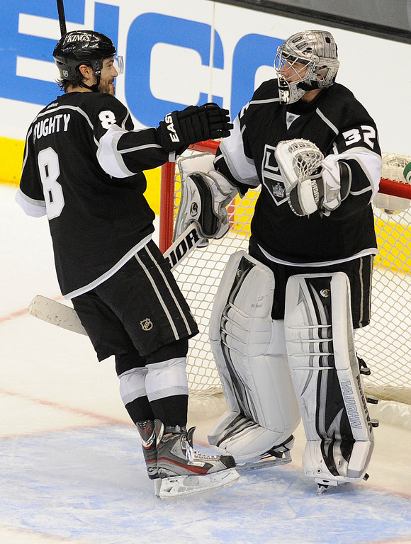 . Kings#8 Drew Doughty congratulates Kings#32 Jonathan Quick at the end of the game. The Kings defeated the San Jose Sharks 2-0 in the first game of the Second Round of the Western Conference Playoffs. Los Angeles CA 5/14/2013(John McCoy/LA Daily News)