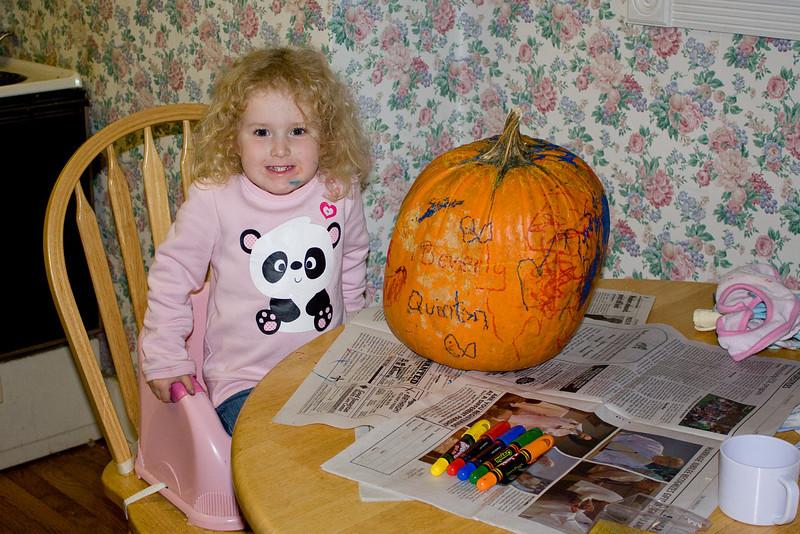 Beverly decorates the pumpkin