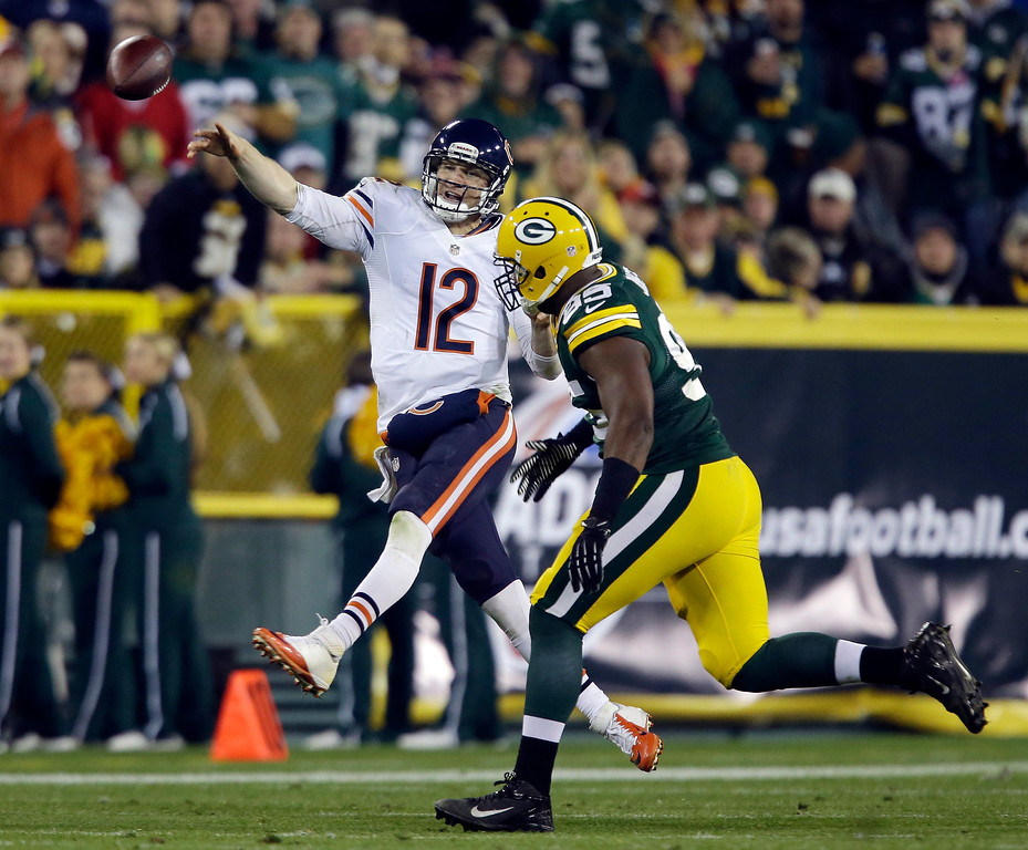 . Chicago Bears quarterback Josh McCown throws past Green Bay Packers\' Datone Jones during the second half of an NFL football game Monday, Nov. 4, 2013, in Green Bay, Wis. (AP Photo/Jeffrey Phelps)