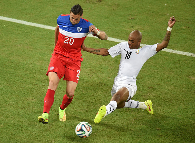 . US defender Geoff Cameron (L) vies with Ghana\'s midfielder Andre Ayew (R) during a Group G football match between Ghana and US at the Dunas Arena in Natal during the 2014 FIFA World Cup on June 16, 2014.   AFP PHOTO / JAVIER SORIANOJAVIER SORIANO/AFP/Getty Images