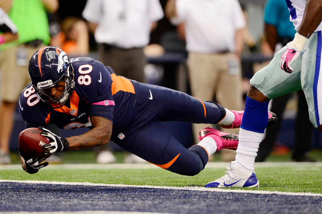 . Julius Thomas (80) of the Denver Broncos dives into the endzone against the Dallas Cowboys during the first half of action at AT&T Stadium.  (Photo by AAron Ontiveroz/The Denver Post)