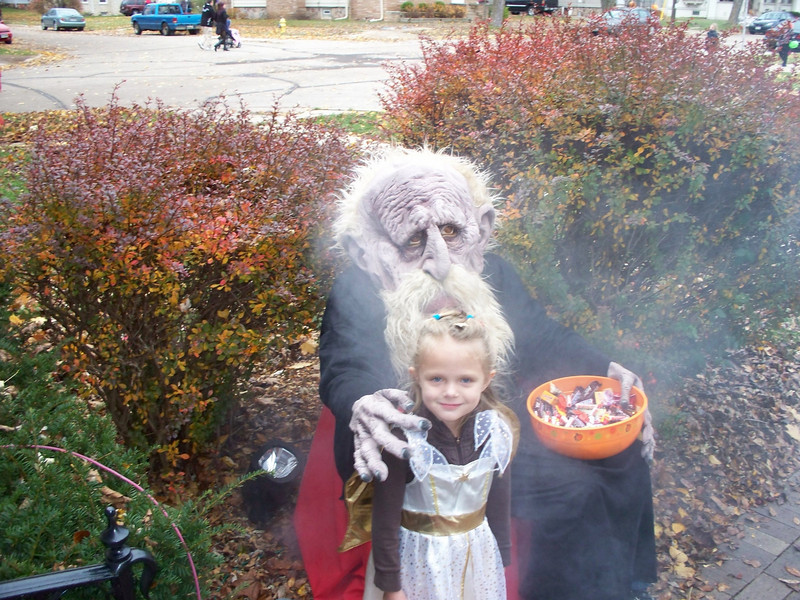 Rachel posing with The Troll after trick-or-treat was over.