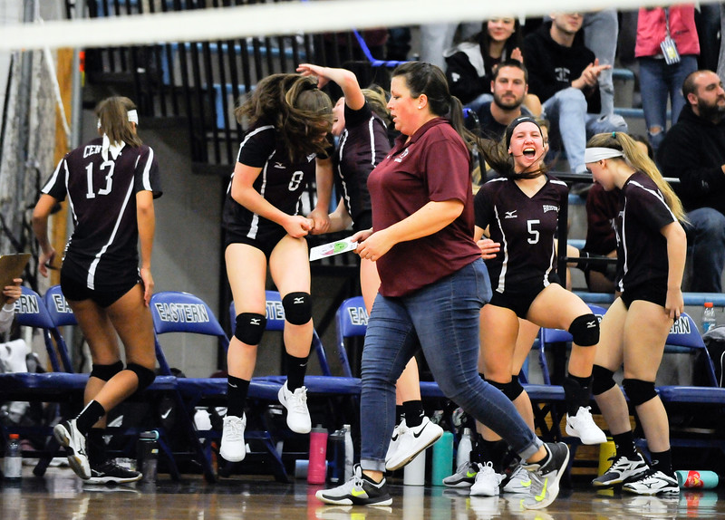 10/22/18  Wesley Bunnell | Staff  Bristol Eastern defeated Bristol Central on Monday night 3-1. Head Coach Holly Willette walks past the bench as players celebrate a point. Alexa Furniss (8) & Brooke Soucy (5).