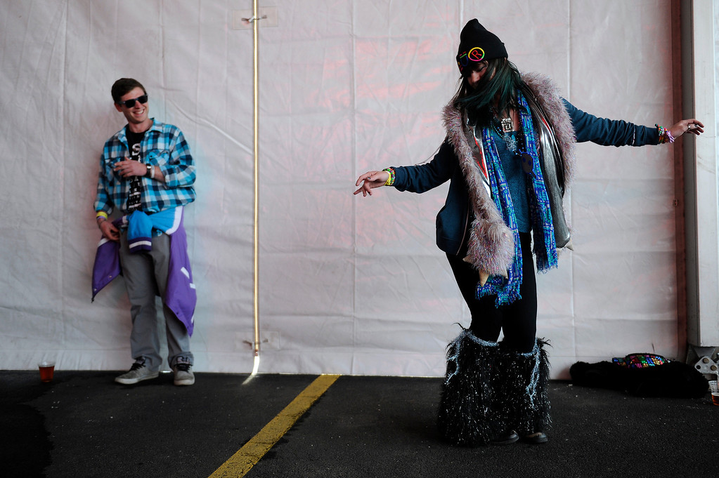 . DENVER, CO - APRIL 4: Jessica Rutherford, 21, of Santa Barbara, Ca., dance as Real Magic performs during the Snowball Music Festival at Sports Authority Field at Mile High Stadium on April 4, 2014 in Denver, Colorado. The Snowball Music Festival is celebrating its first year in Denver after spending the previous three years as a mountain based festival. (Photo by Seth McConnell/The Denver Post)