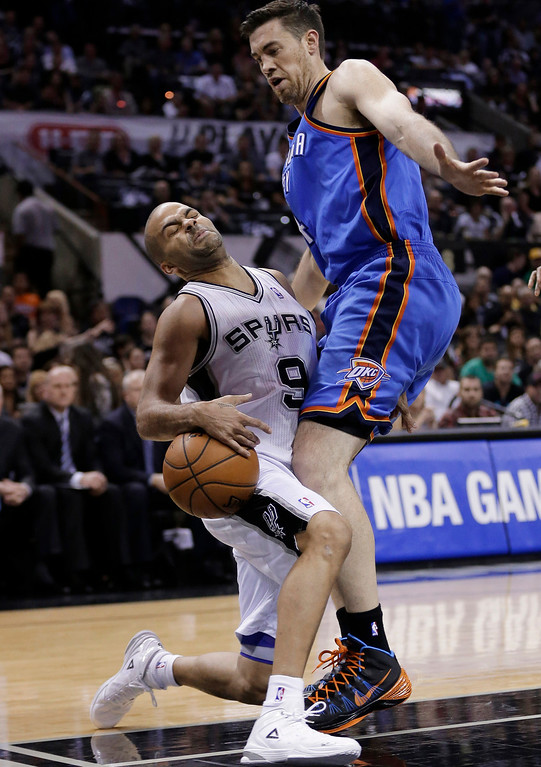 . San Antonio Spurs\' Tony Parker (9), of France, is fouled by Oklahoma City Thunder\'s Nick Collison (4) during the first half of Game 2 of a Western Conference finals NBA basketball playoff series, Wednesday, May 21, 2014, in San Antonio. (AP Photo/Eric Gay)