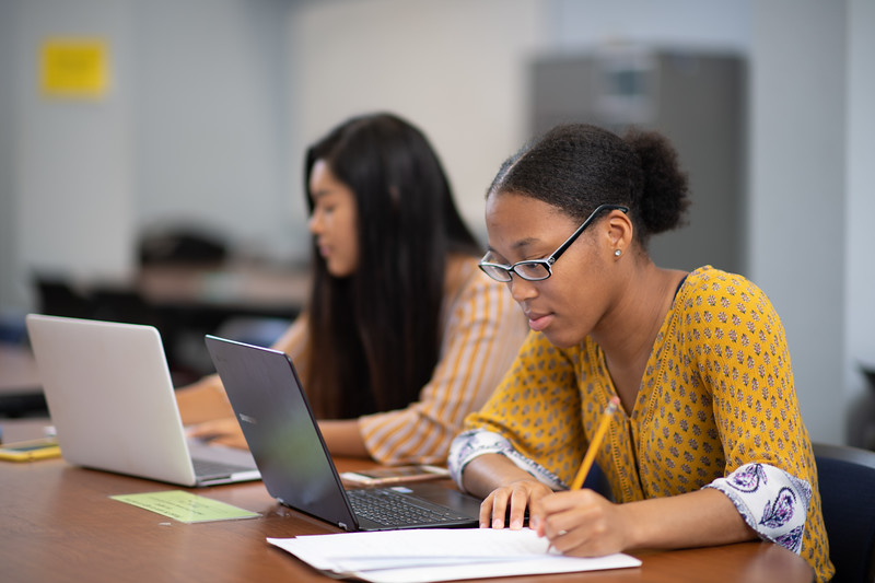 Jen Natiola (left) and Quinneicia Tatum work in tandem on their math studies in the CASA department.