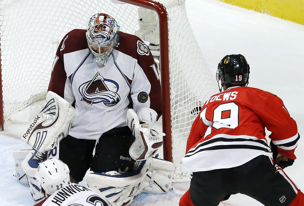 . Colorado Avalanche goalie Semyon Varlamov (1), of Russia, makes a save on a shot by Chicago Blackhawks center Jonathan Toews during the second period of an NHL hockey game, Wednesday, March 6, 2013, in Chicago. (AP Photo/Charles Rex Arbogast)
