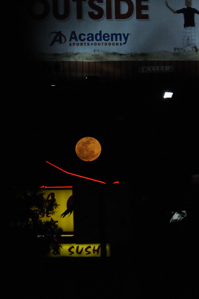 We welcomed the moon over cluttered Airport Boulevard after a fun evening with friends.
