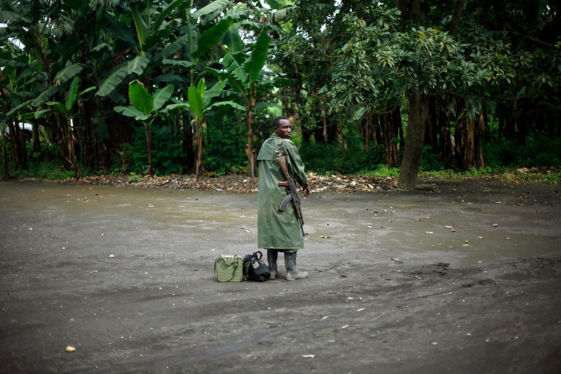 . A M23 rebel stands with his weapon as M23 rebels withdraw from the Masisi and Sake areas in the eastern Congo town of Sake, some 27 kms west of Goma, Friday Nov. 30, 2012. Rebels in Congo believed to be backed by Rwanda postponed their departure Friday from the key eastern city of Goma by 48 hours for ìlogistical reasons,î defying for a second time an ultimatum set by neighboring African countries and backed by Western diplomats. The delay raises the possibility that the M23 rebels donít intend to leave the city they seized last week, giving credence to a United Nations Group of Experts report which argues that neighboring Rwanda is using the rebels as a proxy to annex territory in mineral-rich eastern Congo. (AP Photo/Jerome Delay)