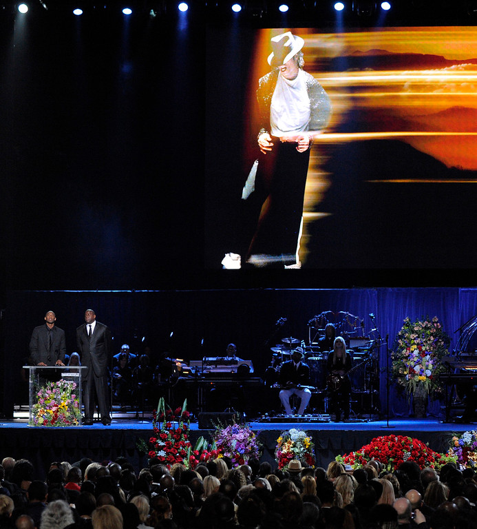 . Kobe Bryant, left, and Magic Johnson speak during the memorial service for Michael Jackson at the Staples Center in Los Angeles, Tuesday, July 7, 2009. (AP Photo/Mark J. Terrill, Pool)