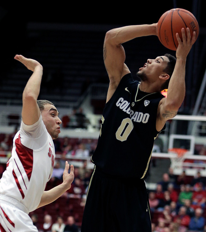 . Colorado\'s Askia Booker, right, shoots over Stanford\'s Aaron Bright during the first half of an NCAA college basketball game Wednesday, Feb. 27, 2013, in Stanford, Calif. (AP Photo/Ben Margot)