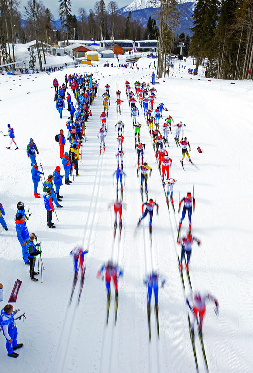 . SOCHI, RUSSIA - FEBRUARY 09:  Skiers compete in the Men\'s Skiathlon 15 km Classic + 15 km Free during day two of the Sochi 2014 Winter Olympics at Laura Cross-country Ski & Biathlon Center on February 9, 2014 in Sochi, Russia.  (Photo by Richard Heathcote/Getty Images)