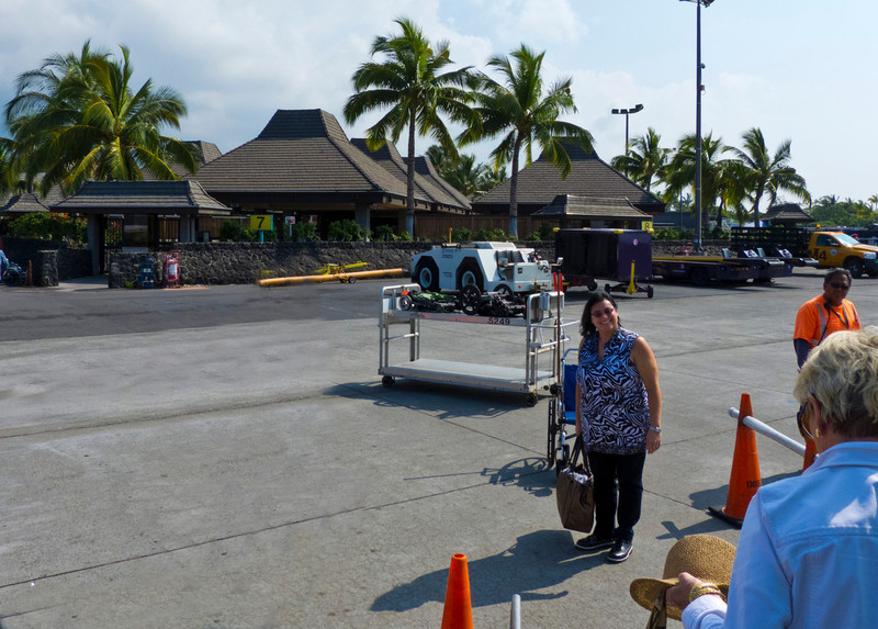 On the tarmac at the  Kailua Kona Airport, where everything is outdoors, even the luggage carousels.
