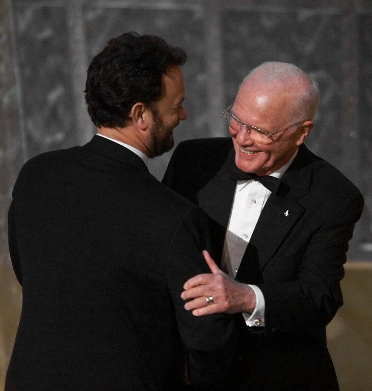 . Astronaut John Glenn, right, is introduced by actor Tom Hanks as part of a tribute to film hereos during the 71st Annual Academy Awards at the Dorothy Chandler Pavilion of the Los Angeles Music Center Sunday, March 21, 1999. (AP Photo/Eric Draper)