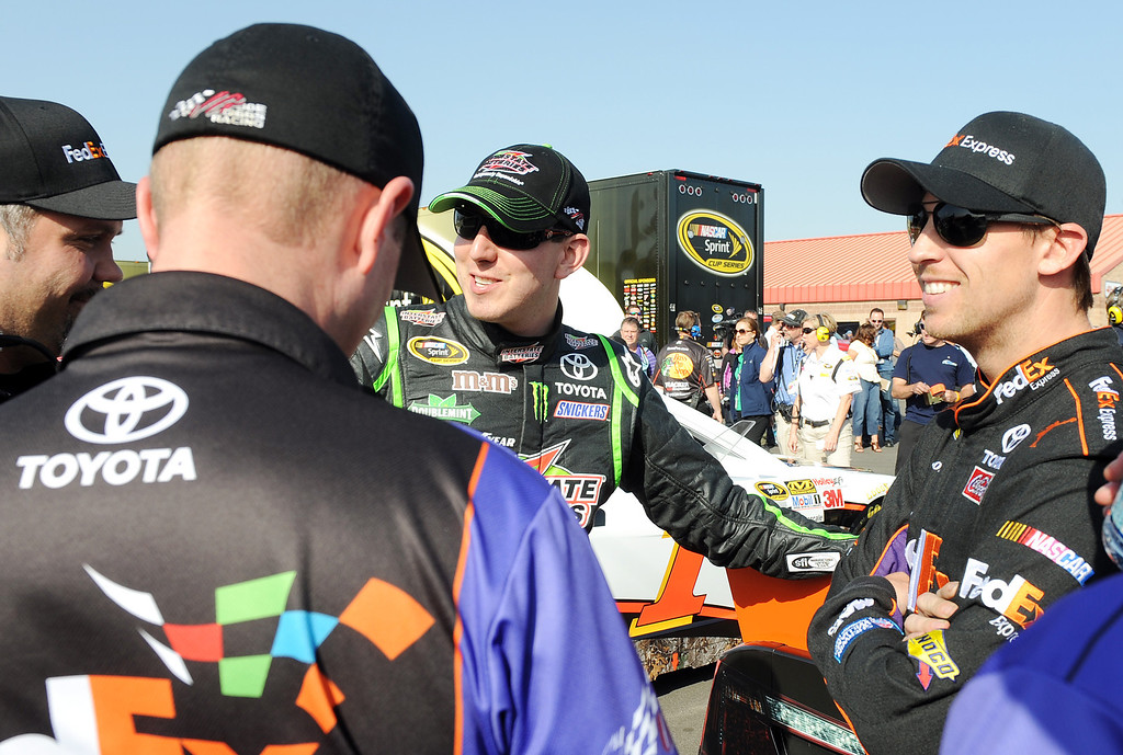 . (Will Lester/Staff Photographer) NASCAR driver Denny Hamlin (right) speaks with team member Kyle Busch Friday. Hamlin won the pole position for Sunday\'s Auto Club 400 Friday March 22, 2013. Hamlin lapped the 2-mile super speedway in 38.410 seconds at an average speed of 187.451mph.