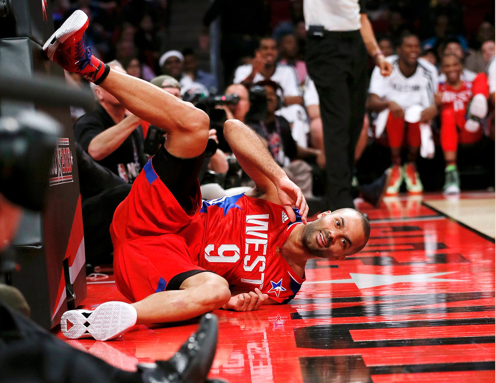 . NBA All-Star Tony Parker of the San Antonio Spurs crashes to the court after making a diving pass during the NBA All-Star basketball game in Houston, Texas, February 17, 2013. REUTERS/Lucy Nicholson (UNITED STATES  - Tags: SPORT BASKETBALL)