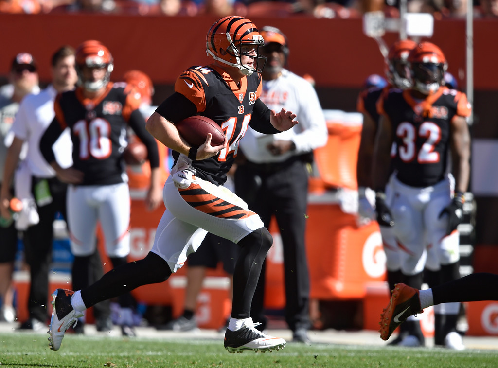 . Cincinnati Bengals quarterback Andy Dalton (14) scrambles in the second half of an NFL football game against the Cleveland Browns, Sunday, Oct. 1, 2017, in Cleveland. (AP Photo/David Richard)