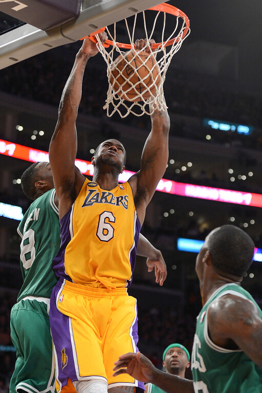 . Lakers Earl Clark slams in two points as Celtics\' Jeff Green defends  during second half action at Staples Wednesday. Lakers defeated the Celtics 113-99.  Photo by David Crane/Staff Photographer