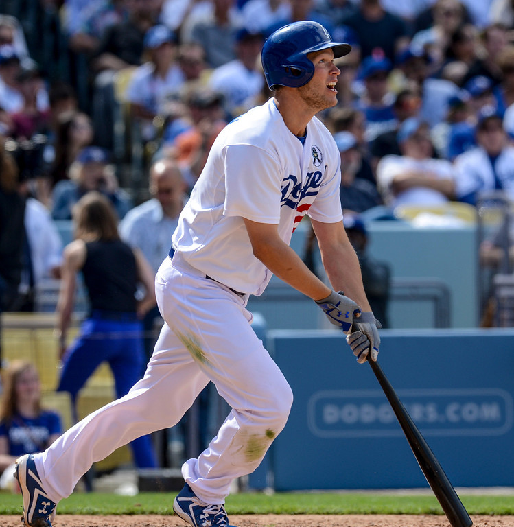 . Dodger\'s Clayton Kershaw watches his hit go over the fence in the 8th inning during opening day at Dodger Stadium Monday.  Dodgers defeated the Giants 4-0.  Photo by David Crane/Los Angeles Daily News.
