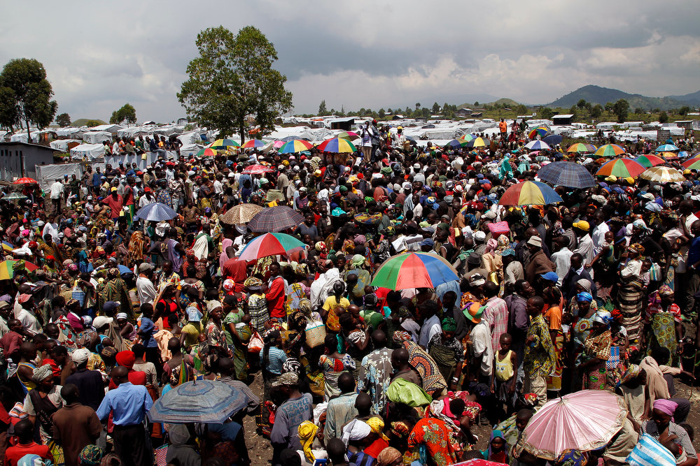 . Internally displaced Congolese  wait for food to be distributed by WFP at the Mugunga 3 camp outside the eastern Congolese town of Goma Sunday Dec. 2, 2012. Rebels say they will take back Congo\'s city of Goma if the government does not agree to negotiate with them by Monday. The M23 rebels completed their withdrawal of the eastern Congo city on Saturday, in compliance with an agreement reached between the rebel group and a regional body. (AP Photo/Jerome Delay)