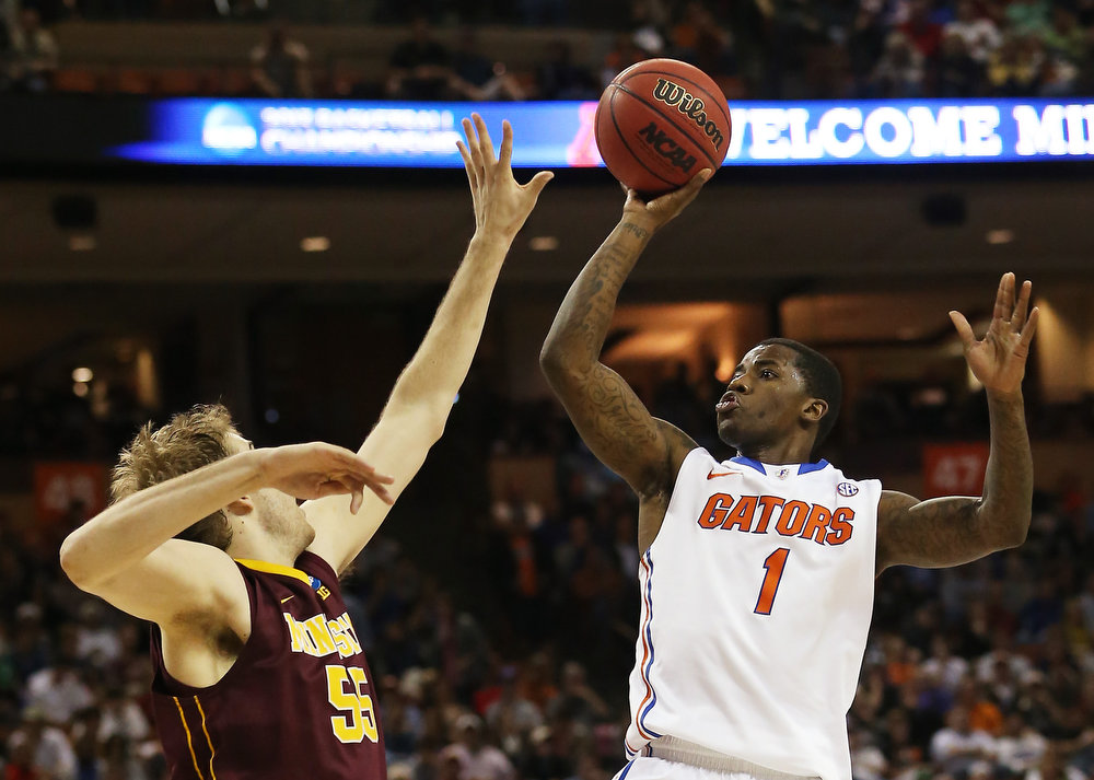 . Kenny Boynton #1 of the Florida Gators goes up against Elliott Eliason #55 of the Minnesota Golden Gophers in ther first half during the third round of the 2013 NCAA Men\'s Basketball Tournament at The Frank Erwin Center on March 24, 2013 in Austin, Texas.  (Photo by Ronald Martinez/Getty Images)