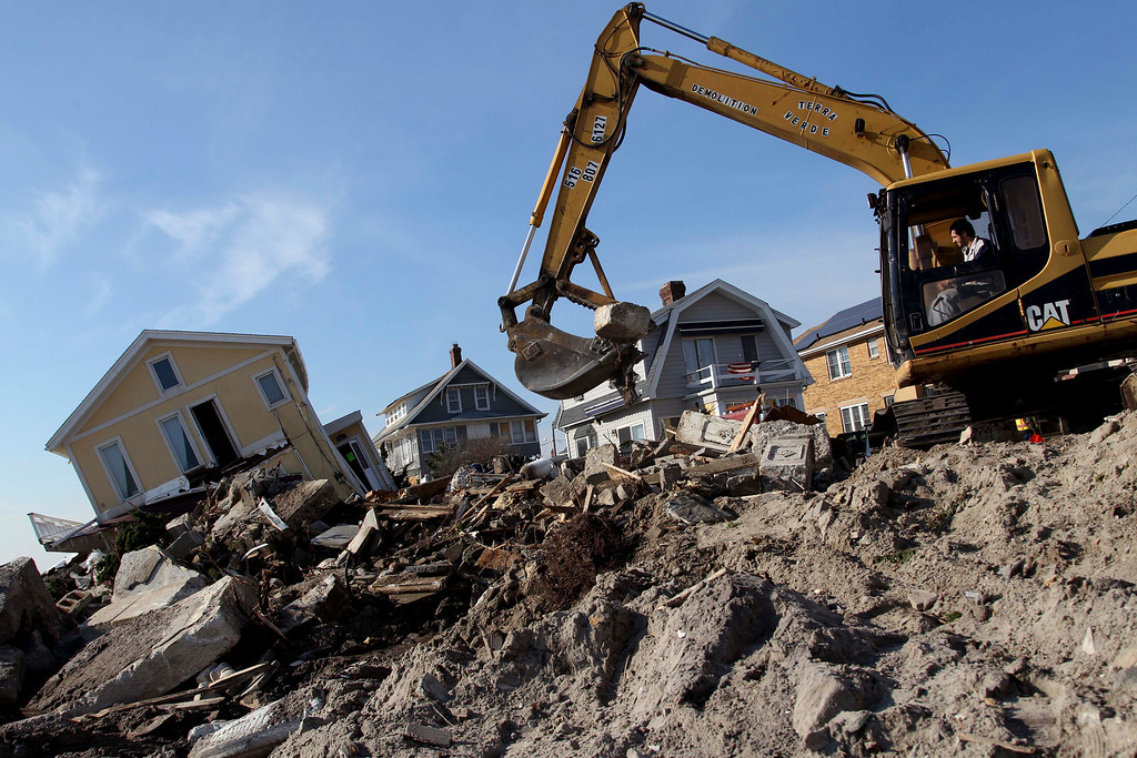 . Clean up continues on the site of a demolished home on the Rockaway Peninsula in New York, Thursday, Nov. 29, 2012. Sandy damaged or destroyed  305,000 housing units in New York.   (AP Photo/Seth Wenig)