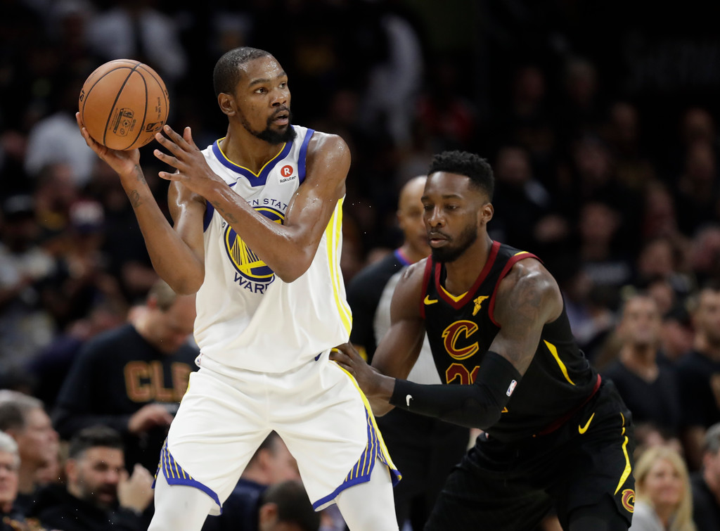 . Golden State Warriors\' Kevin Durant is defended by Cleveland Cavaliers forward Jeff Green (32) in the second half of Game 3 of basketball\'s NBA Finals, Wednesday, June 6, 2018, in Cleveland. (AP Photo/Tony Dejak)