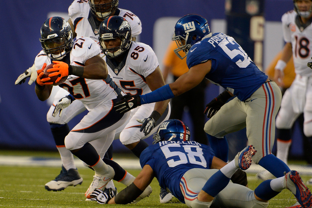 . Wide receiver Demaryius Thomas (88) of the Denver Broncos makes the catch and fumbles then middle linebacker Mark Herzlich (58) of the New York Giants tapes the ball to running back Knowshon Moreno (27) of the Denver Broncos who runs the ball for a first down at METLIFE Stadium. September 15, 2013 East Rutherford, NJ. (Photo By Joe Amon/The Denver Post)