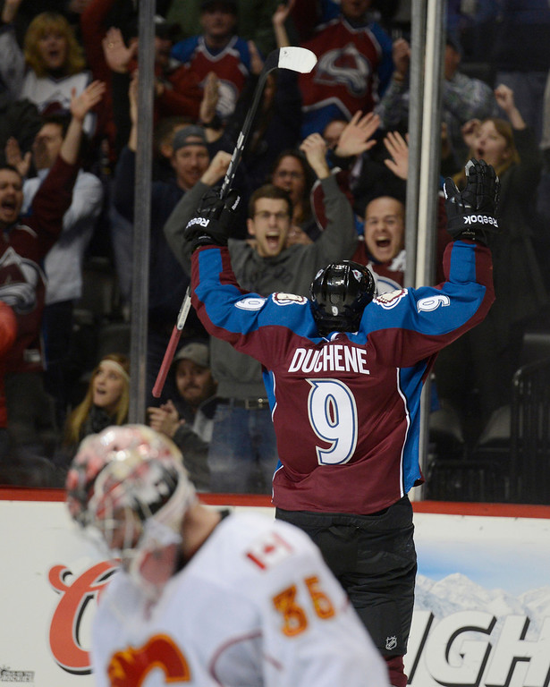 . DENVER, CO. - FEBRUARY 28: Matt Duchene (9) of the Colorado Avalanche celebrates his game winning goal in the third period as Joey MacDonald (35) of the Calgary Flames kneels dejected February 28, 2013 at Pepsi Center.(Photo By John Leyba/The Denver Post)