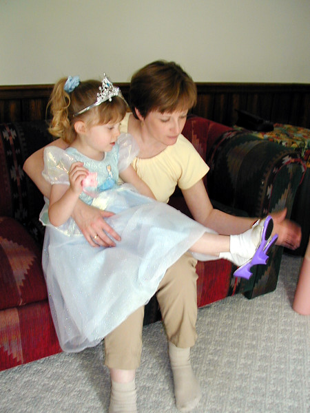 Mommy tries the glass slipper on Charity.JPG