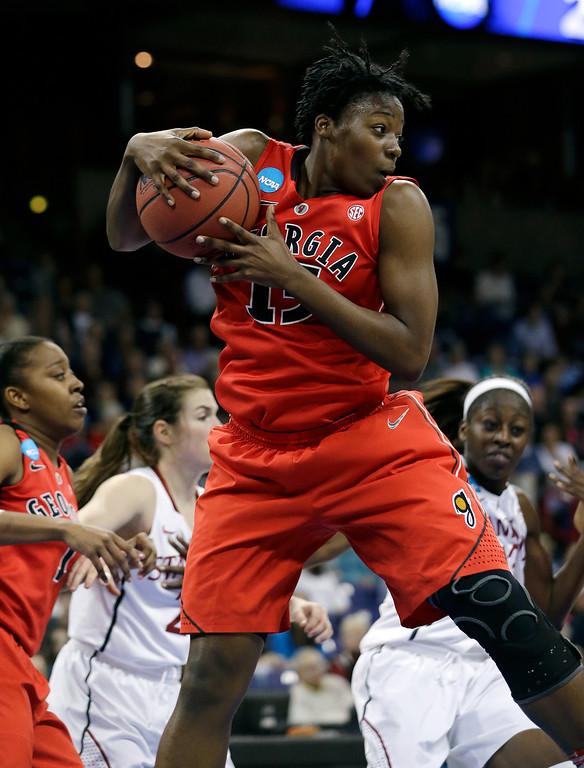 . Georgia\'s Krista Donald comes down with a rebound against Stanford in the first half of a regional semifinal game in the NCAA women\'s college basketball tournament Saturday, March 30, 2013, in Spokane, Wash. (AP Photo/Elaine Thompson)